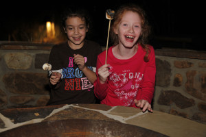 Girl Scouts make s'mores at the Savanna fire pit during a Lights Out overnight. Dallas Zoo/Cathy Burkey