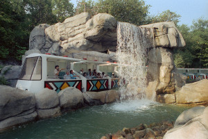 The Monorail Safari crosses under its cool waterfall in August 1990, soon after it opened. Nearly 4 million people have ridden the monorail in its 25-year history.