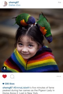 FIRST PLACE: Instagramer Emily Gomez photographs her daughter Emma with a few rainbow lorikeets.