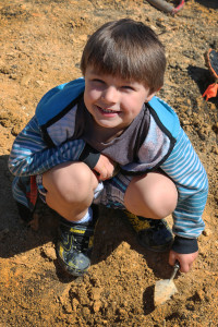 Wylie helps unearth the dinosaur fossil he discovered.