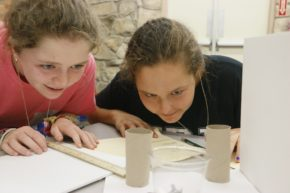 Two girls work on designing an animal habitat for Zoo by Design camp (grades 6-8).