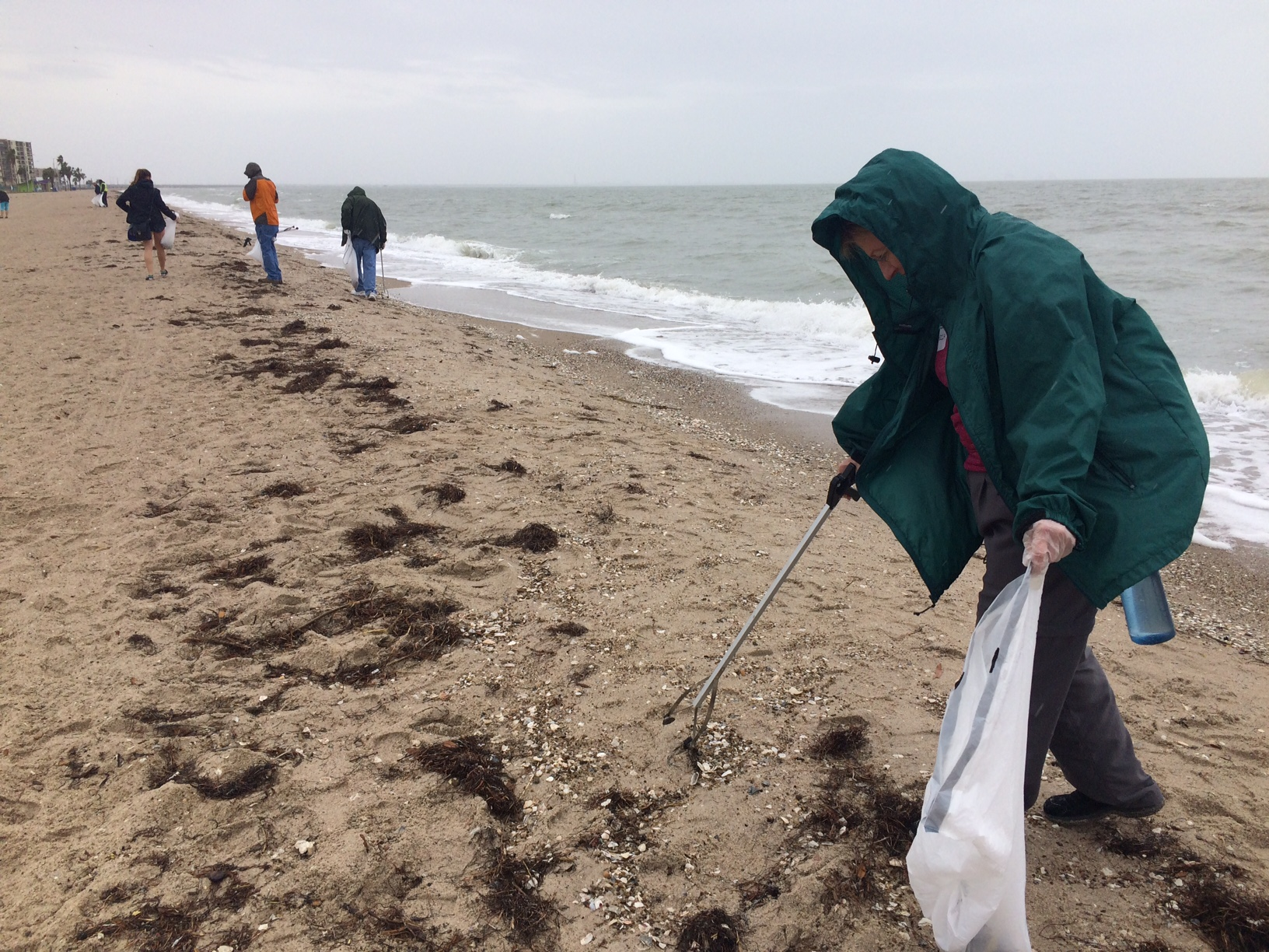 Removing litter from Corpus Christi's North Beach